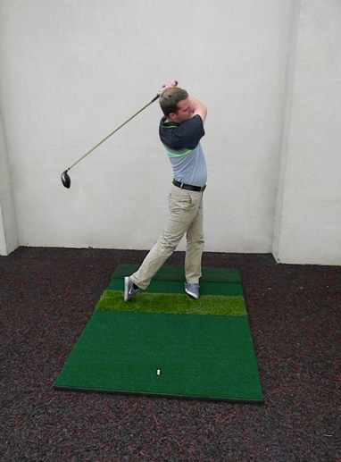 Picture of golfer swinging golf club at sports center