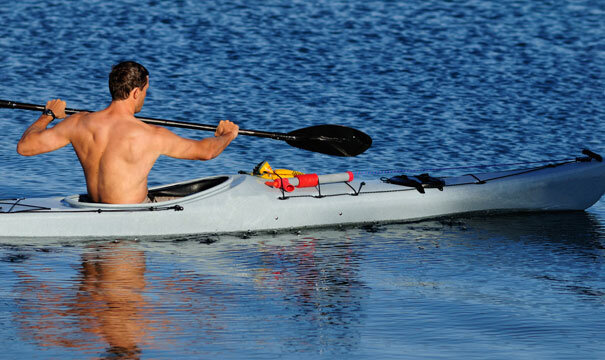 Man kayaking for back and spine exercise.