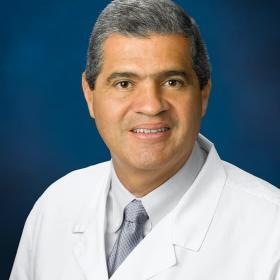 Dr. Carlos Tandron