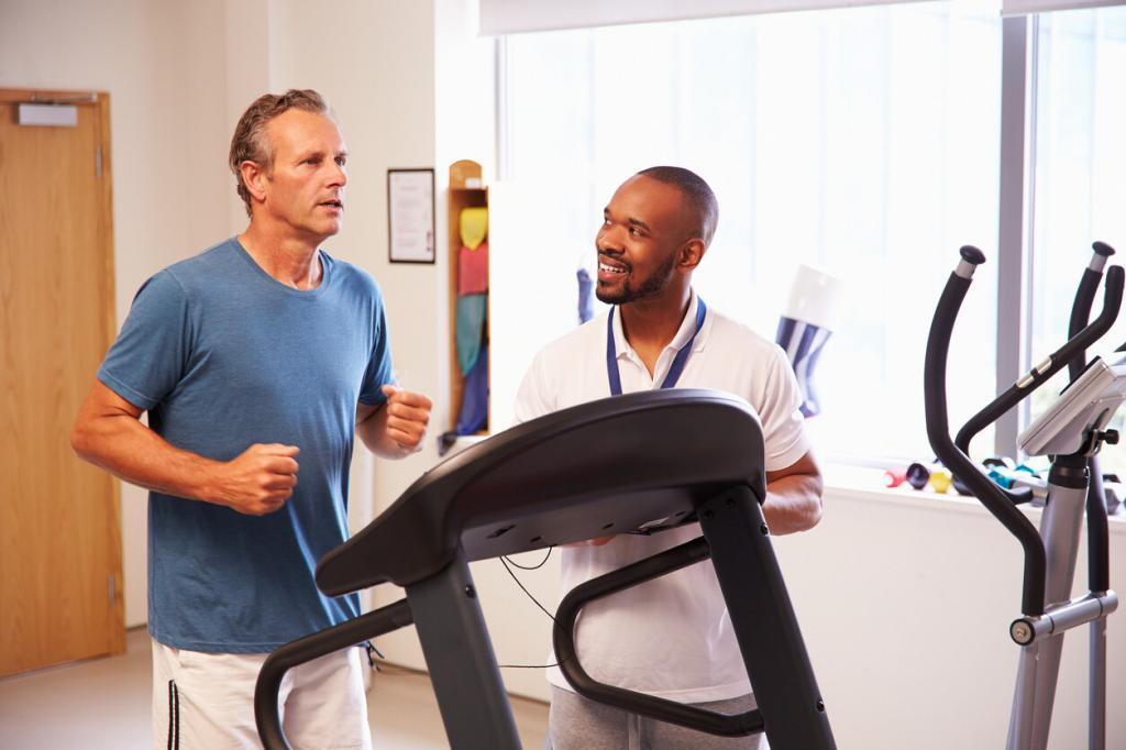 Picture of therapist talking to patient on treadmill